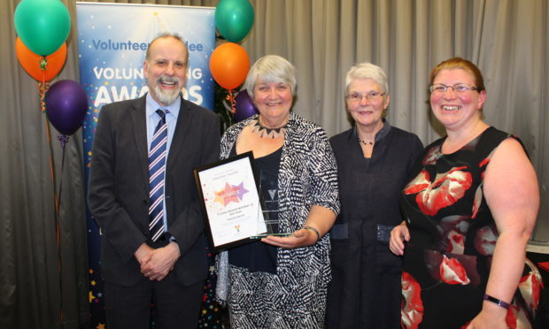 Pam at last year's volunteer awards along with Volunteer Dundee CEO Eric Knox and her colleagues from Dundee Women's Aid.