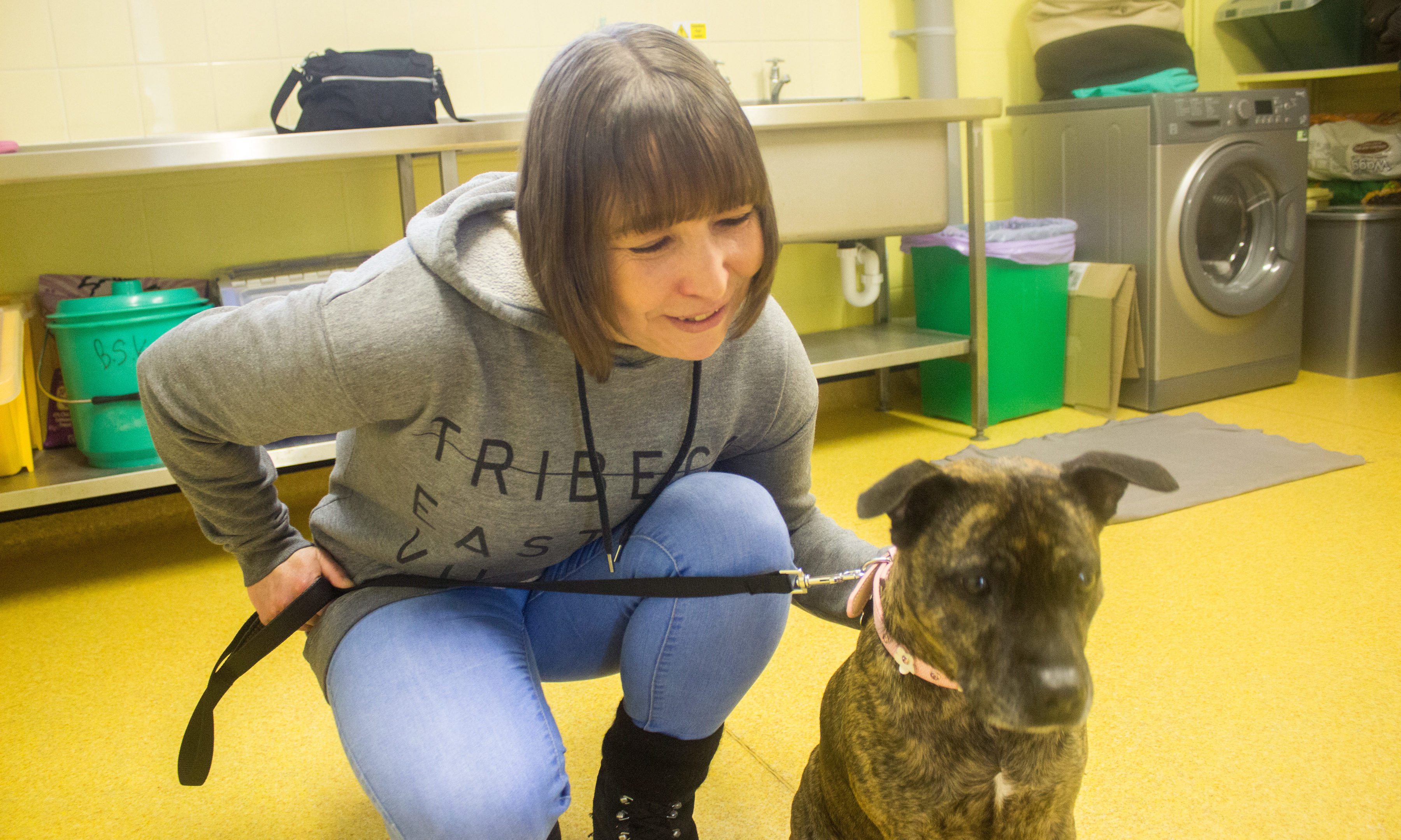 Heather with her dog Rio, who she took home from the kennels.