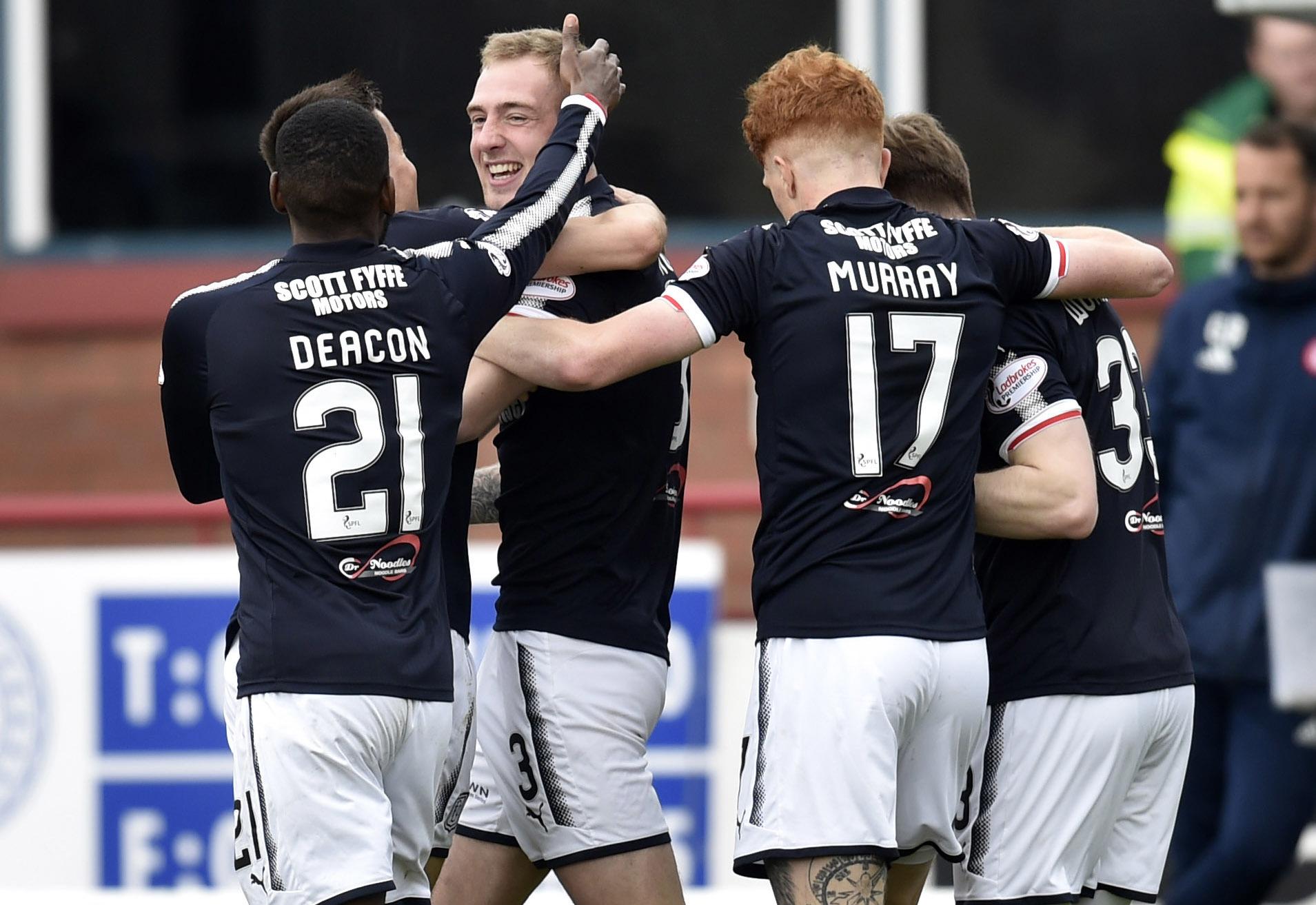 05/05/18 LADBROKES PREMIERSHIP   DUNDEE V HAMILTON   DENS PARK - DUNDEE  Dundee's Kevin Holt (3) celebrates his goal with the Dundee team