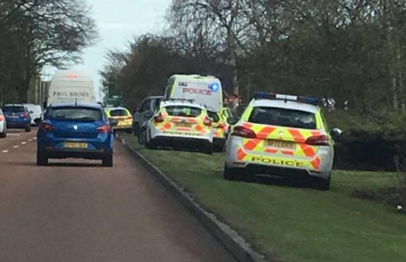 Police on the Kingsway beside Caird Park