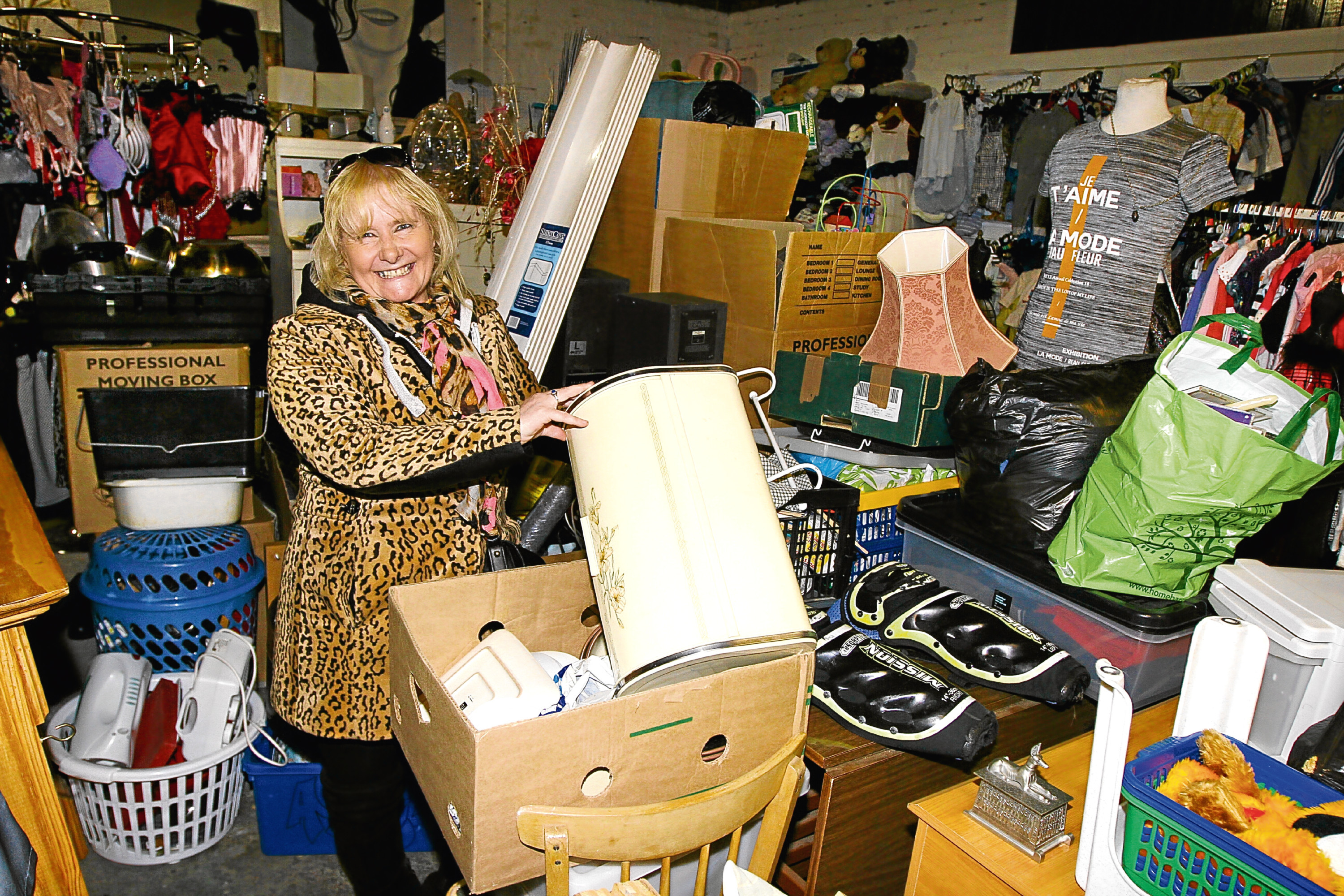 A delighted Deborah pictured with some of the new stock at Ollie's Bring and Buy.