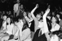 Screaming Beatles fans at the Caird Hall in 1964, at the height of Beatlemania.