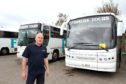 Fishers Tours driver Ian Maich beside his bus, the back of which was hit by a car whose driver failed to stop outside Grove Academy in Broughty Ferry.
