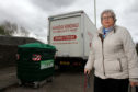 Joan Chalmers of Broughty Ferry community council beside one of the bins.