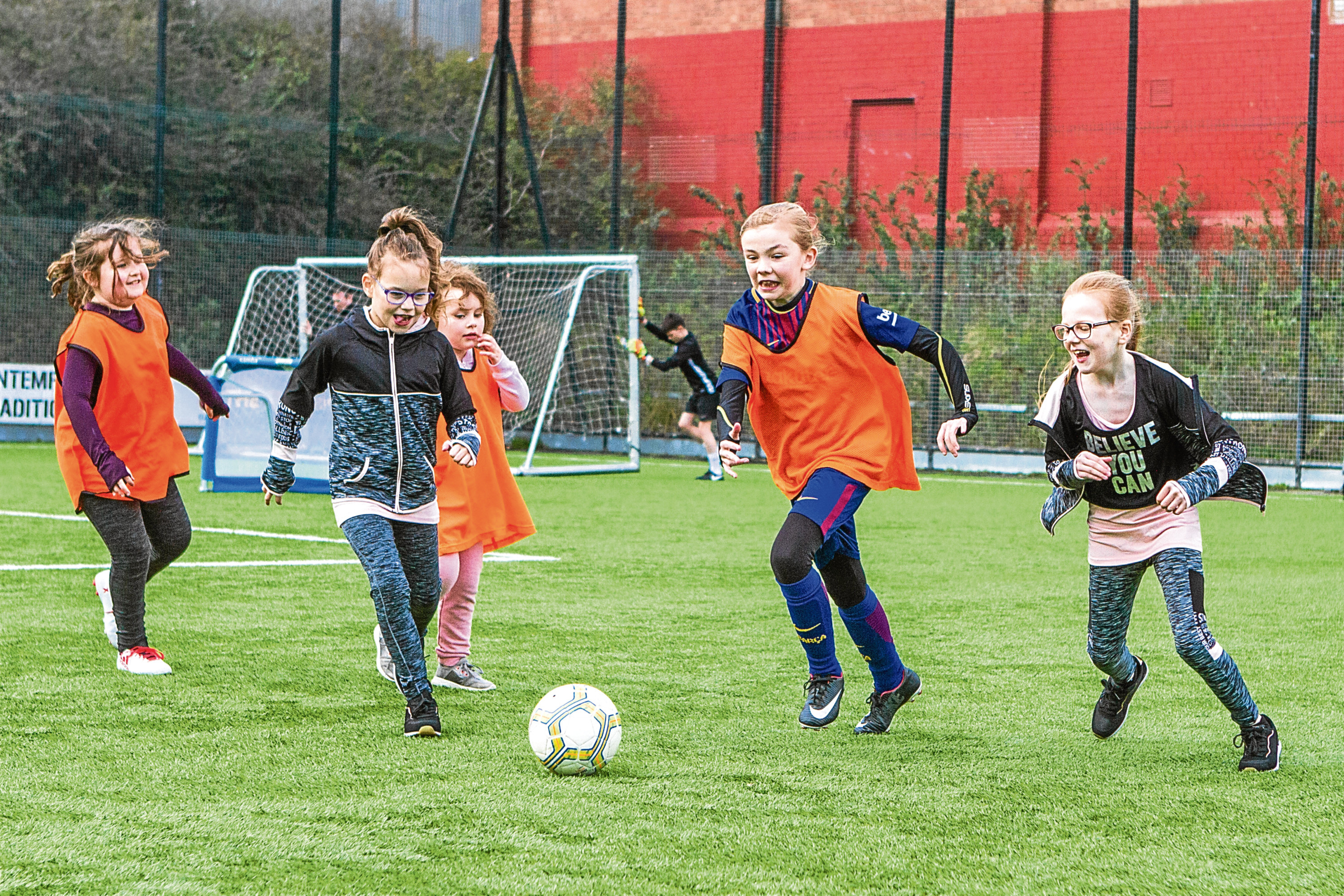 Tele News - Dundee - Sarah Williamson Story. CR0000594 Launch of new Lisa Evans Soccer Centre Club for girls Primary 1 to 7, organised by Dundee United Community Trust. Picture shows, left to right, Caoimhe Strachan (aged 9), Sabina Higgins (aged 10), Hannah Simpson (aged 5), Amy Smith (aged 11) with the ball and Anna Higgins (aged 9). GA Arena, Gussie Park, Tannadice Park, Tannadice Street, Dundee. Monday 16th April 2018.