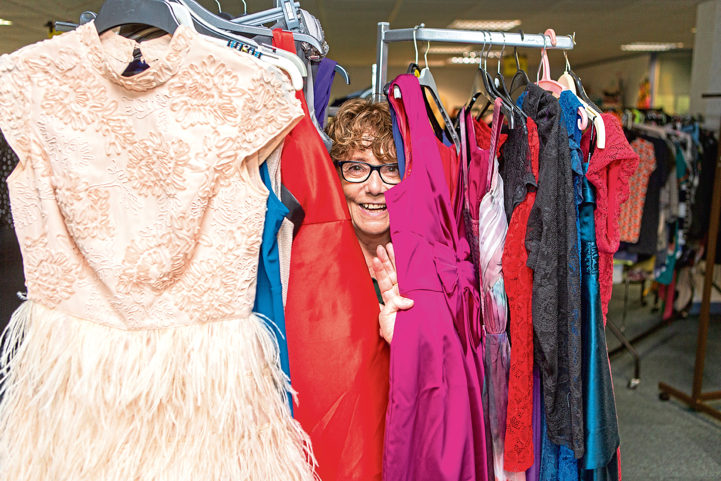 Margaret Whittaker with some of the outfits already donated