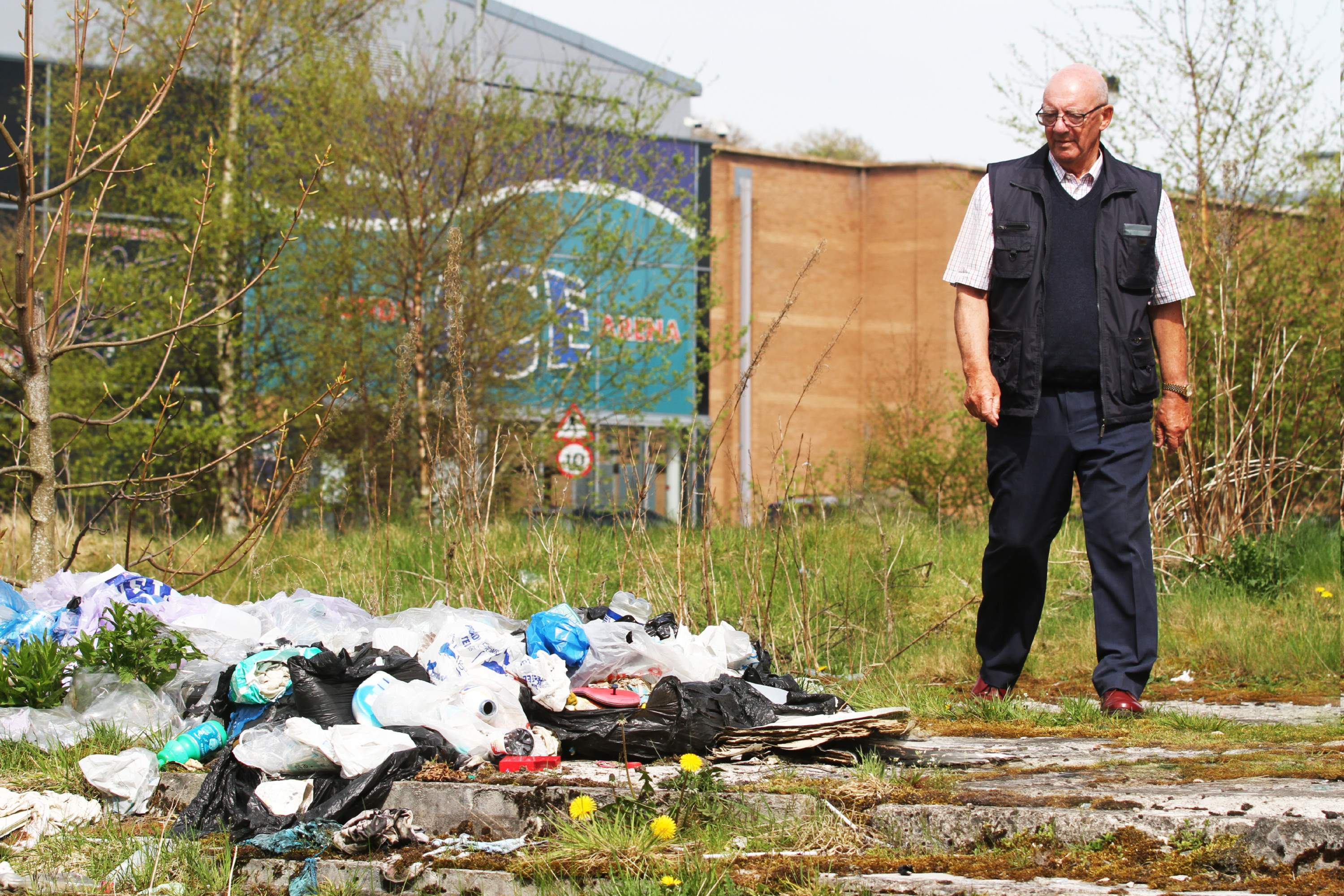 John McNaughton has criticised the fly-tipping which has been going on behind the ice arena, which will host an international tournament next month.