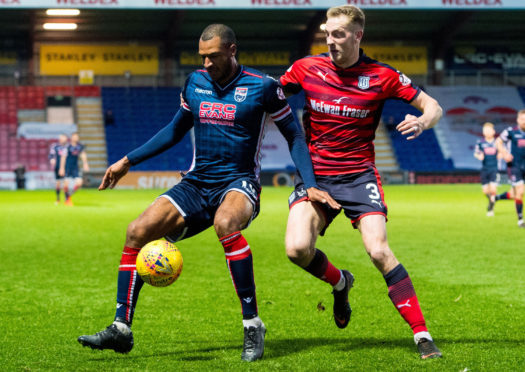 Dundee defender Kevin Holt keeps a close eye on Ross County's David N'Gog at Victoria Park.