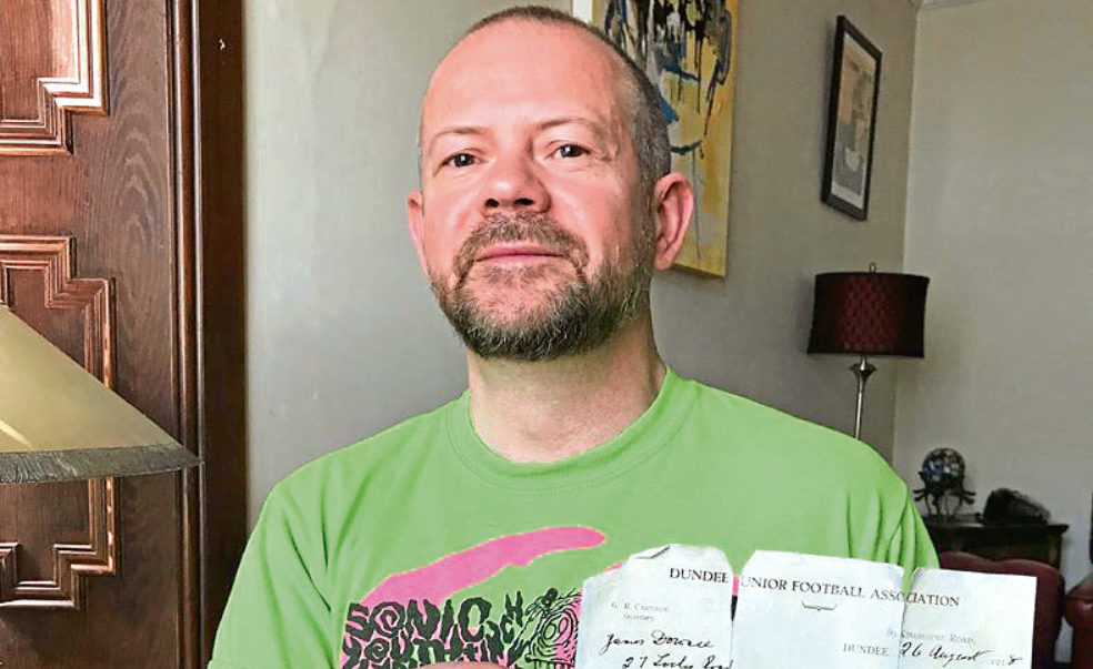 Alan Cormack with his uncle's footballing suspension letter dating back to 1938