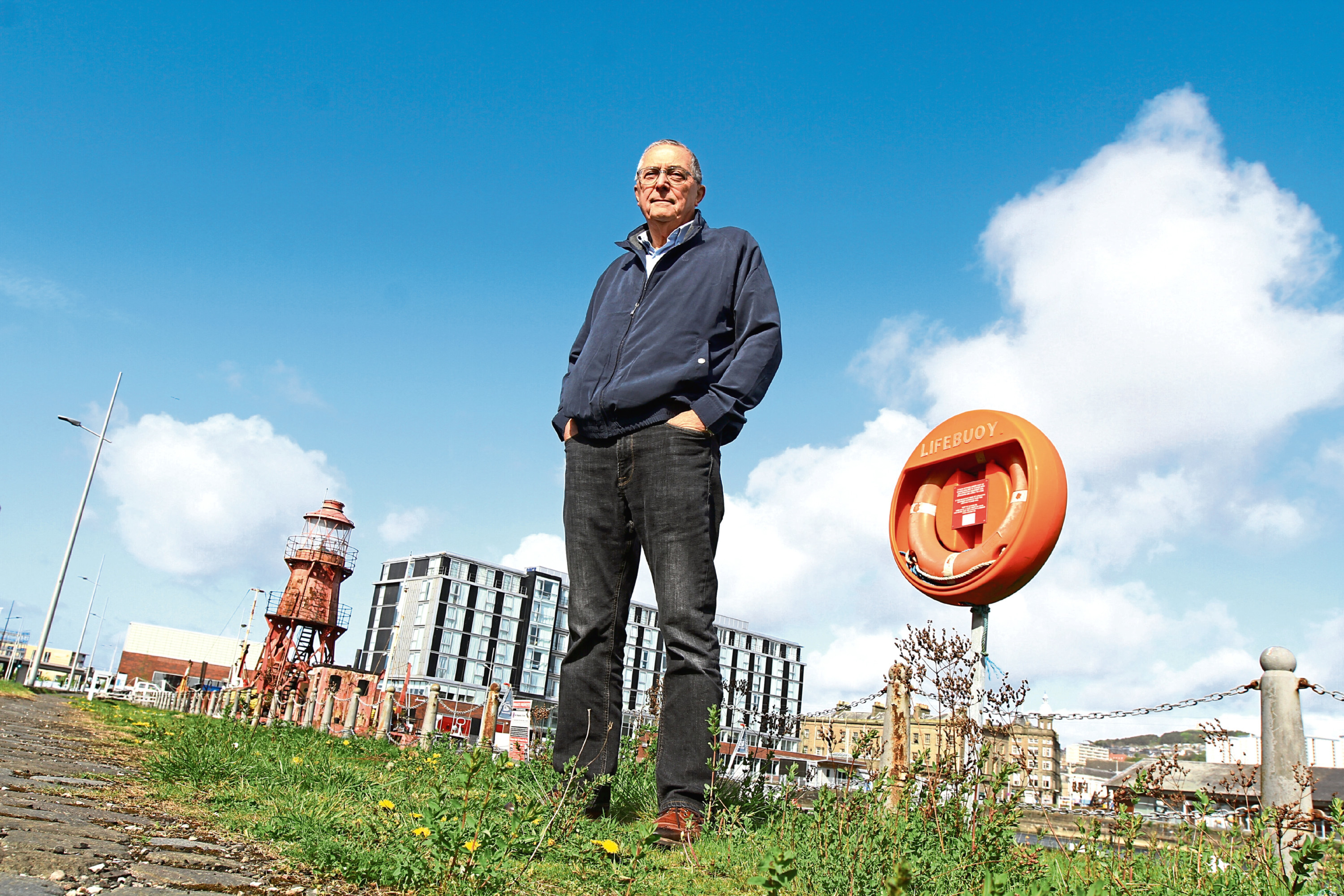 Bill Newcombe beside some of the weeds at City Quay