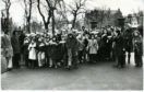 Sponsored Walk at Bacter Park. Photograph showing over 250 school children on a sponsored walk for Help the Aged. Frak Kopel, Jocky Scott and Doug Houston start the walk at Baxter Park, Dundee. 16 February 1975. B88 1975-02-16 Sponsored Walk at Baxter Park (C)DCT BitD. Used in Courier L/ED 17 February 1975.