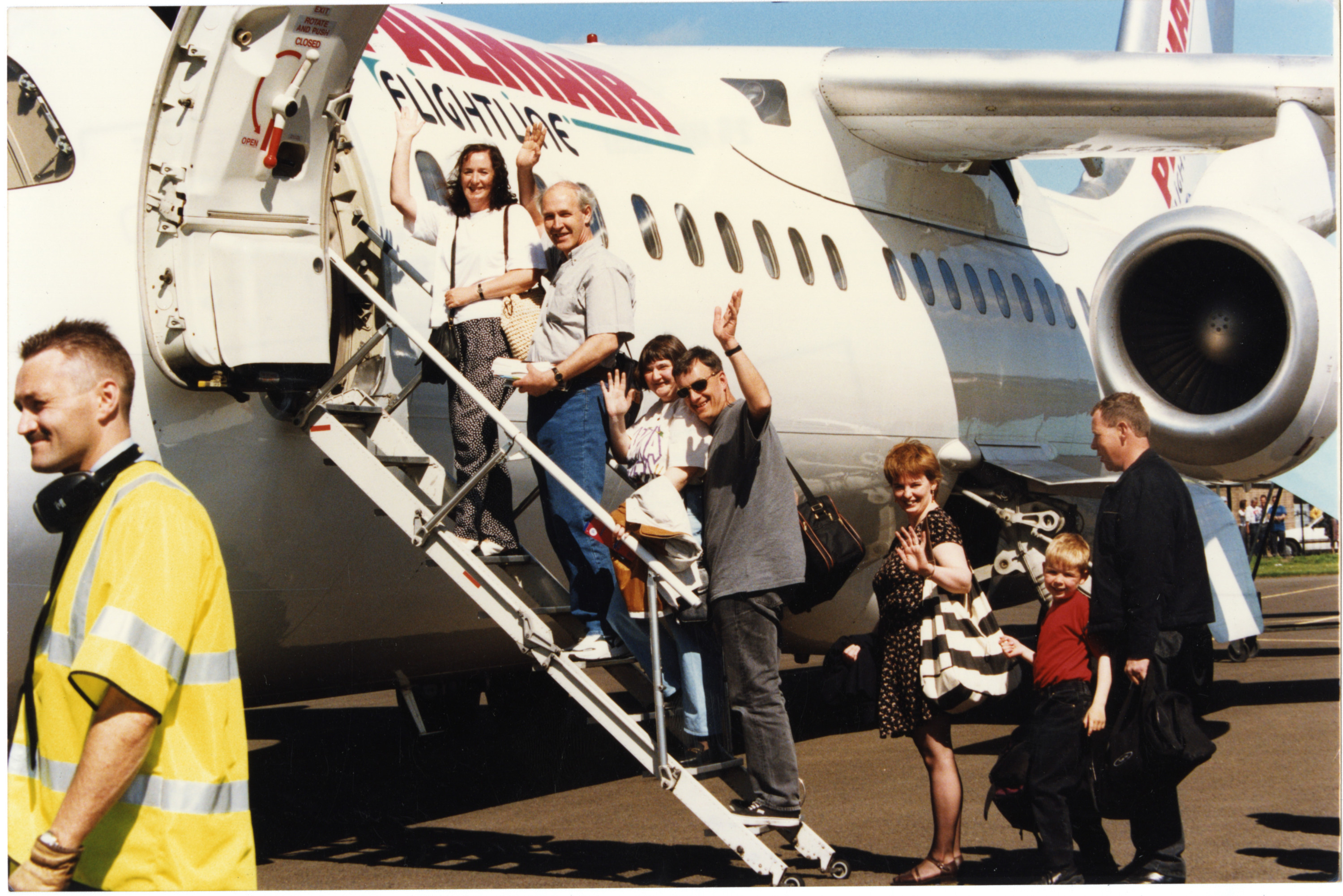 Dundonians Leaving for Holiday. Photograph showing a gorup of Dundonians a they board a plane heading for Majorca. 26 May 1997. H262 1997-05-26 Dundonians Leaving for Holiday (C)DCT Dundonian.