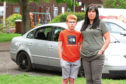 Jill and Ronnie Stewart, 11 with the vehicle which was broken into