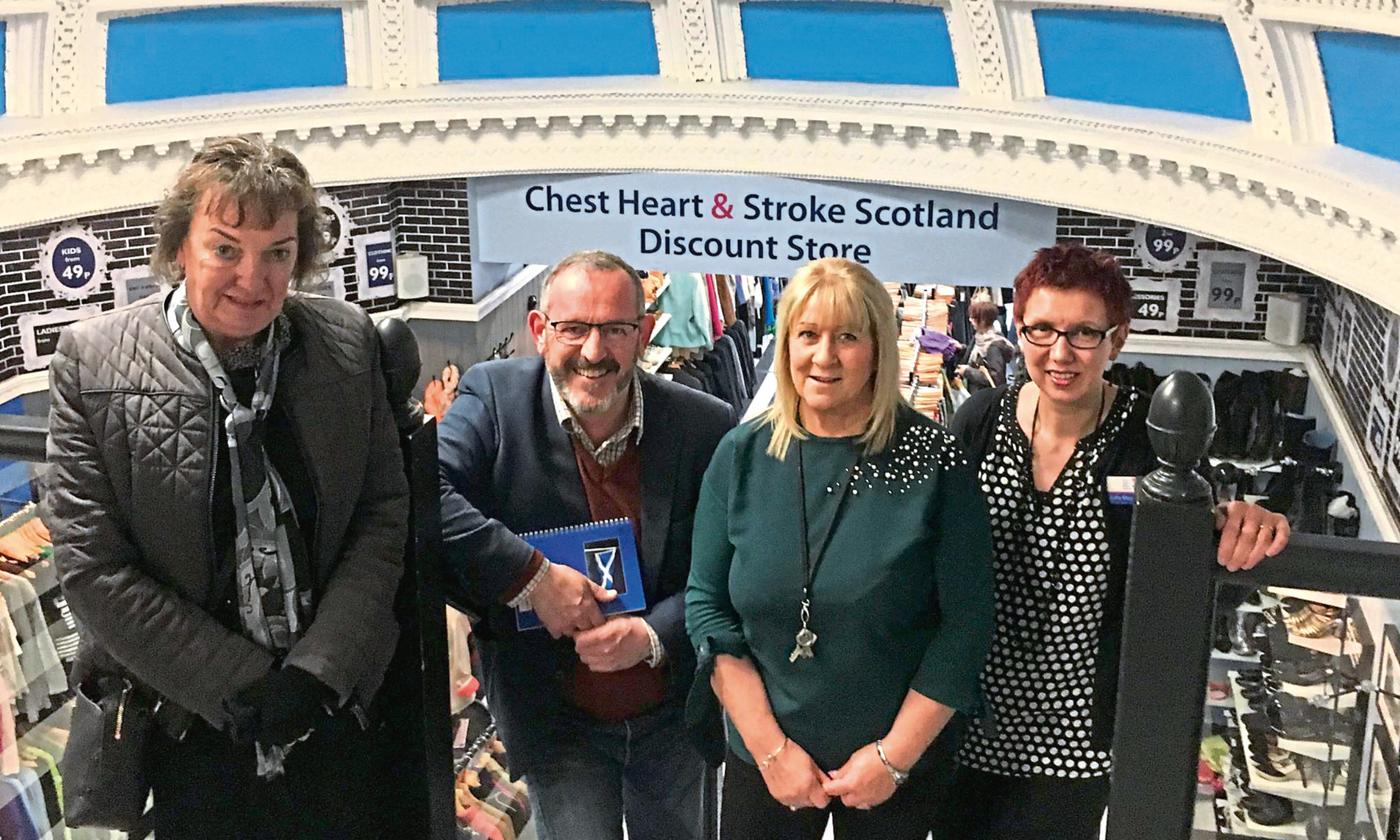 Mr Hosie with staff in the Dundee shop