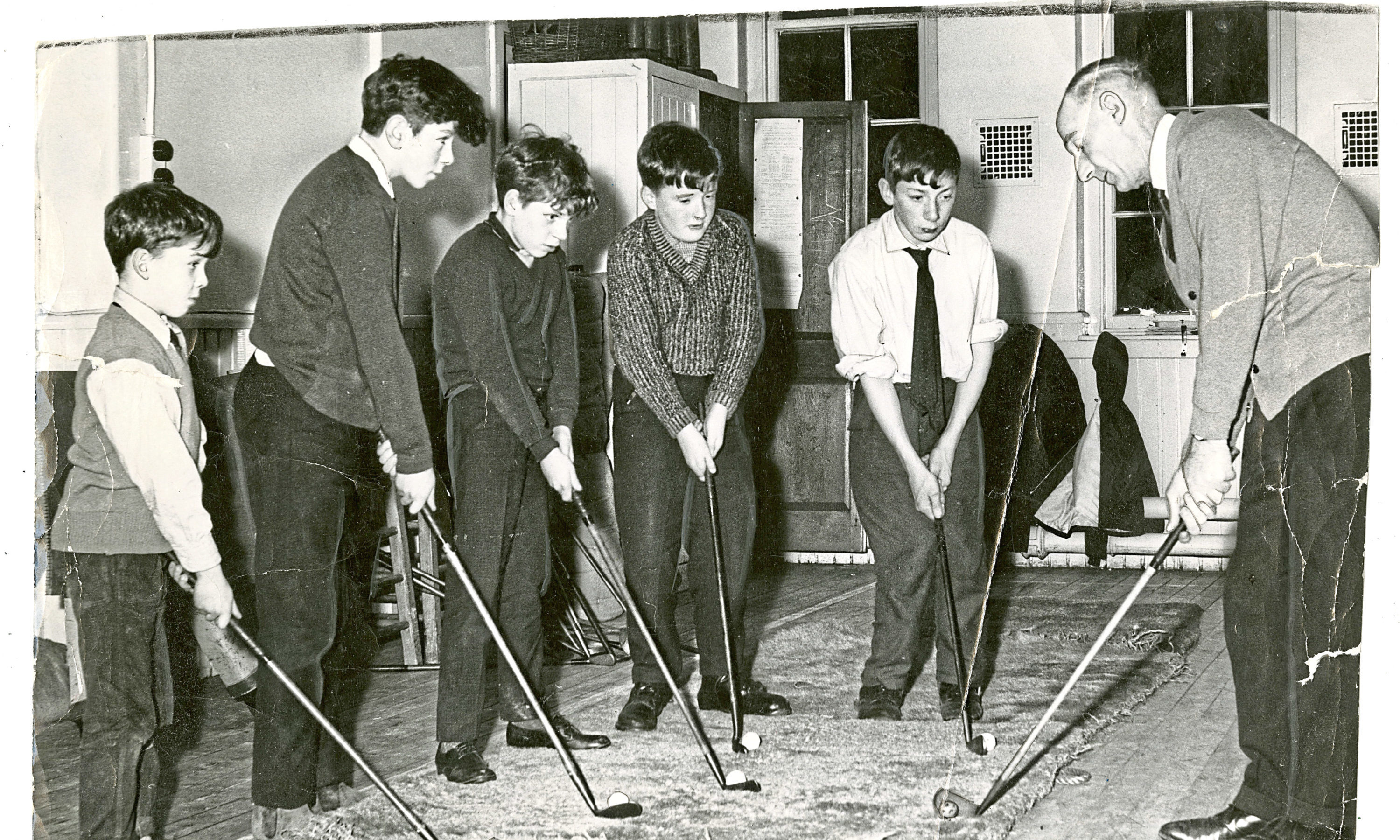 Back in the Day - Saturday 19 May 18 Children at Fairmuir School get a golf lesson from Downfeild Professional Fred Walker and pupils, (from left) John Horbus, Michael O'Neill, James McDonell, David Brown, John Clark. C402 1966-01-10 Children at Fairmuir School Dundee get a golf lesson (C)DCT
