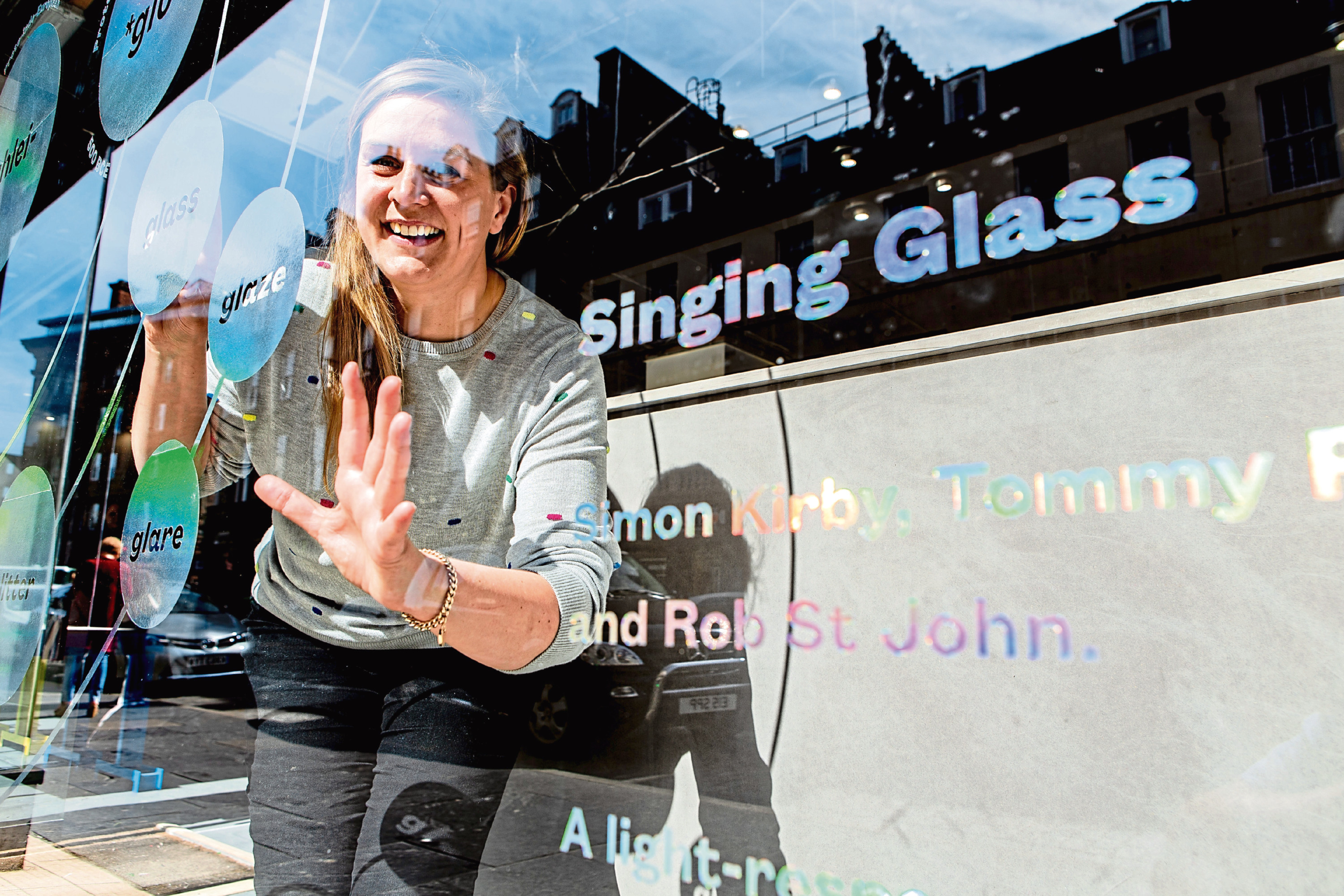 A vibrating window plays music for UNESCO worker Annie Mars