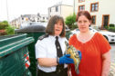 Kirsty Sturrock and Scottish SPCA officer Beverley O'Lone with the rescued terrapin.