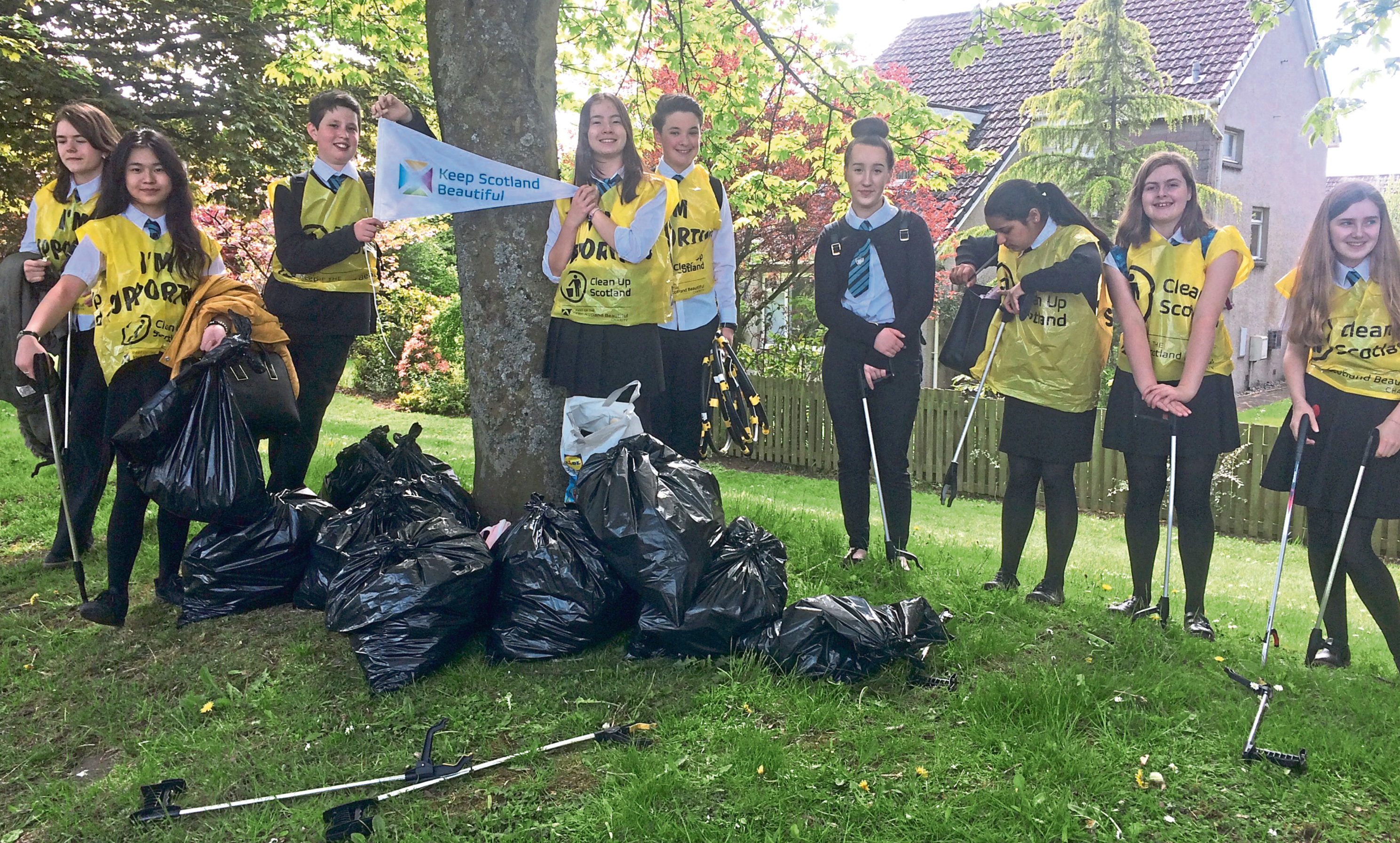 Pupils with bags of litter after their hard work