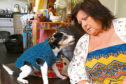 Joan Boyle with her dog Lady, at home.