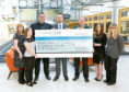 Picture shows Henderson Loggie staff handing over their cheque to Dundee Foodbank.
