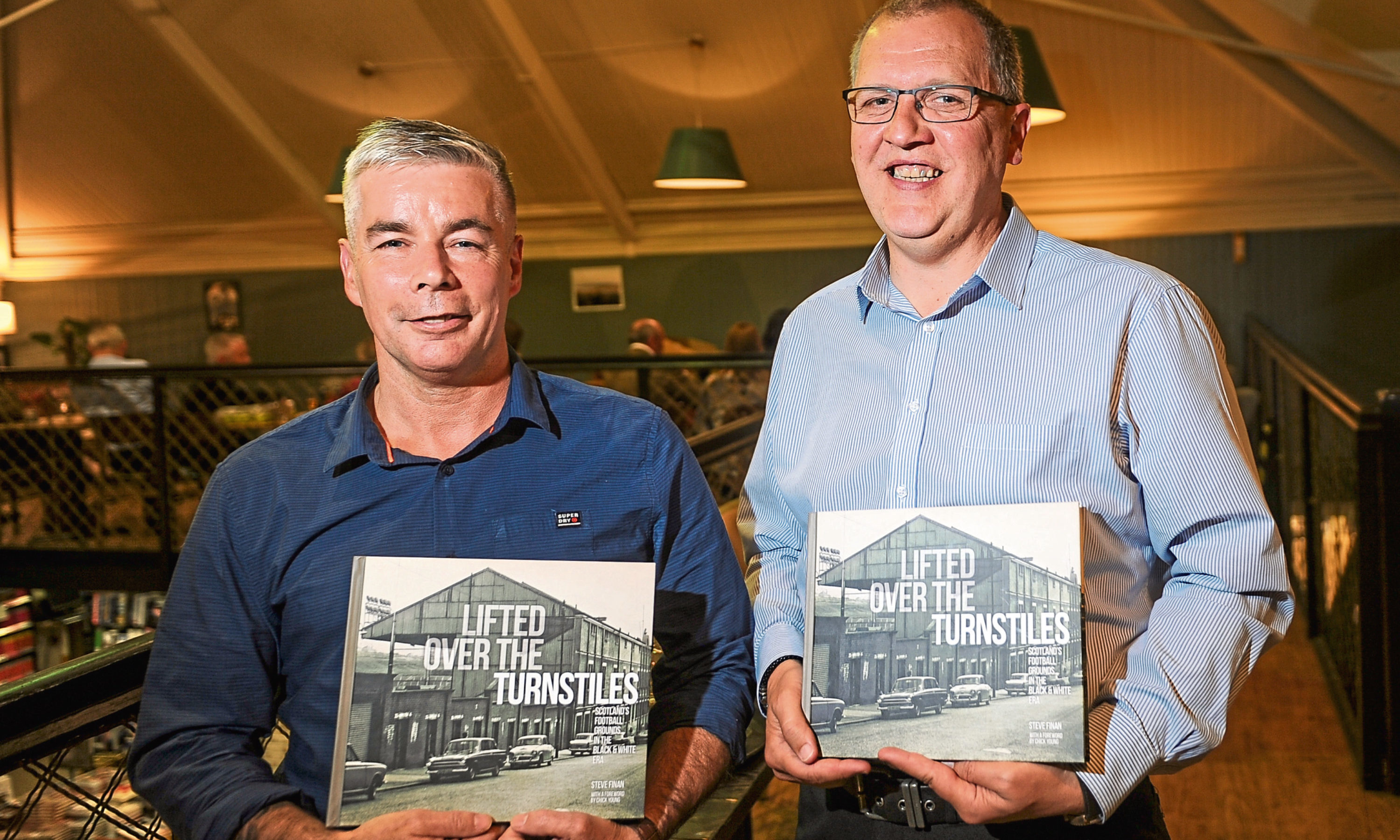 Courier News - Dundee, Stefan Morkis story; CR0001605 Launch of new DC Thomson book Lifted Over the Turnstiles. Picture shows; l to r - Steve Finan (author) and Tom Duthie, Waterstones, Commercial Street, Dundee, Tuesday 29th May 2018