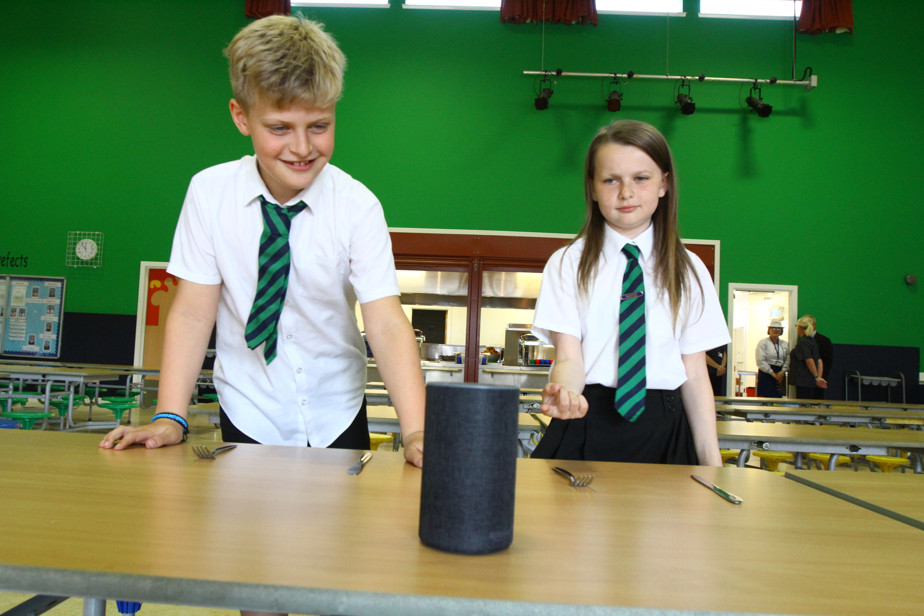 David Bachanek, P4, and Caitlin Walsh, P6, with Alexa which enables them to find out what is on the menu for school dinners