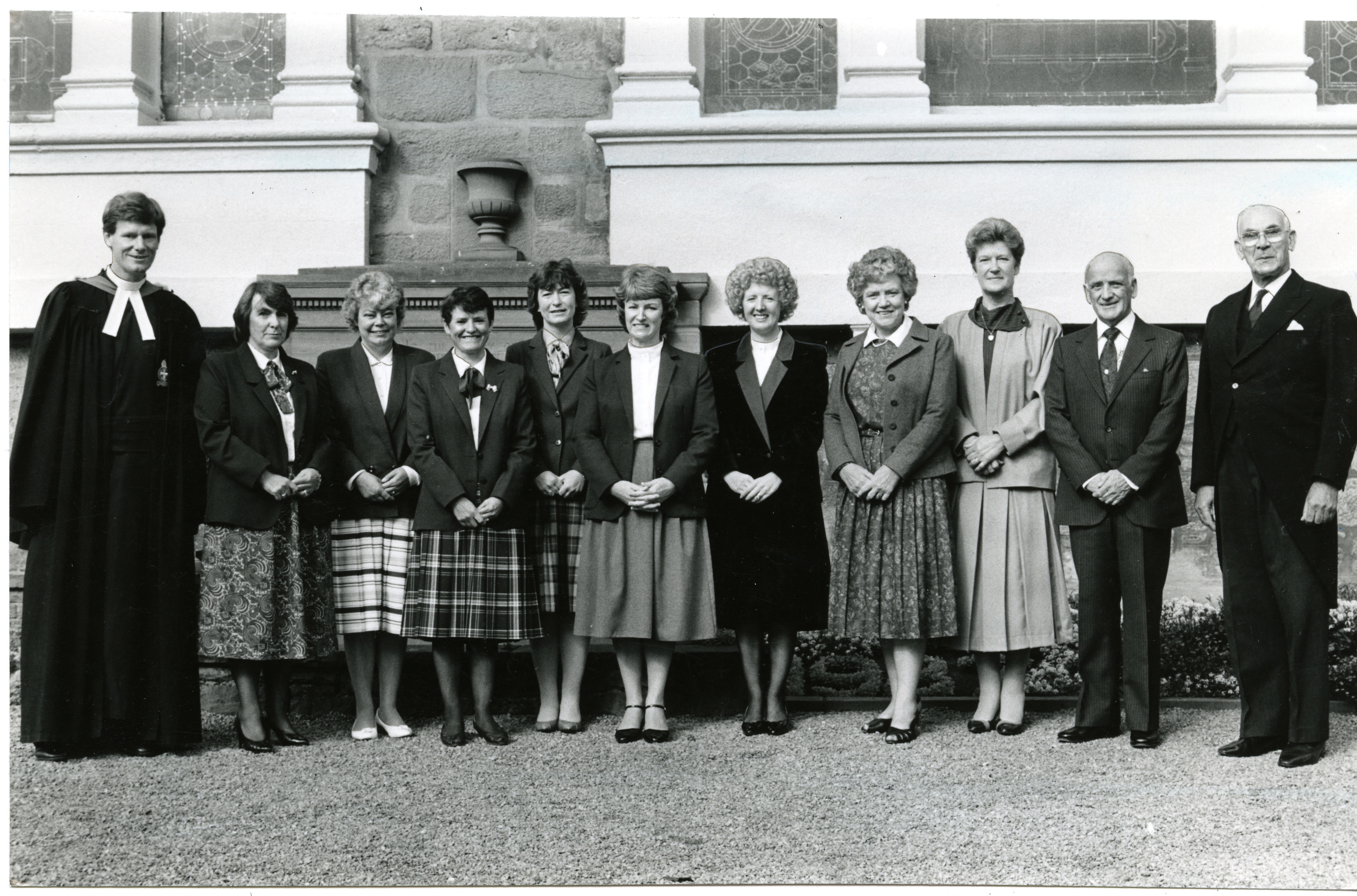 First Women Elders. Photograph showing the group of first women elders to be inducted to St Andrews Parish Church in 213 years. L/R: Rev Ian Petrie, Sheila Baird, Jay Scott, Helen Holden, Sheila Valentine, Audrey Ower, Merelyn Baxter, Mr Mudie, Christine Cant, John Risk and Bruce Leslie, session clerk. 26 September 1987. H252 1987-09-26 First Women Elders (C)DCT Dundonian. Used in Courier L/ED 1987-09-28.