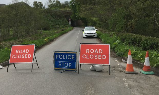 Police on the scene as they probe an unexplained death near the B8062 Auchterarder to Dunning Road
