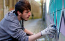 Artist Liam Palermo painting in Mary Ann Lane