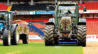 A tractor getting the Dundee United's Tannadice pitch ready for next season