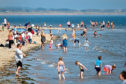 People cooling off in Broughty Ferry beach