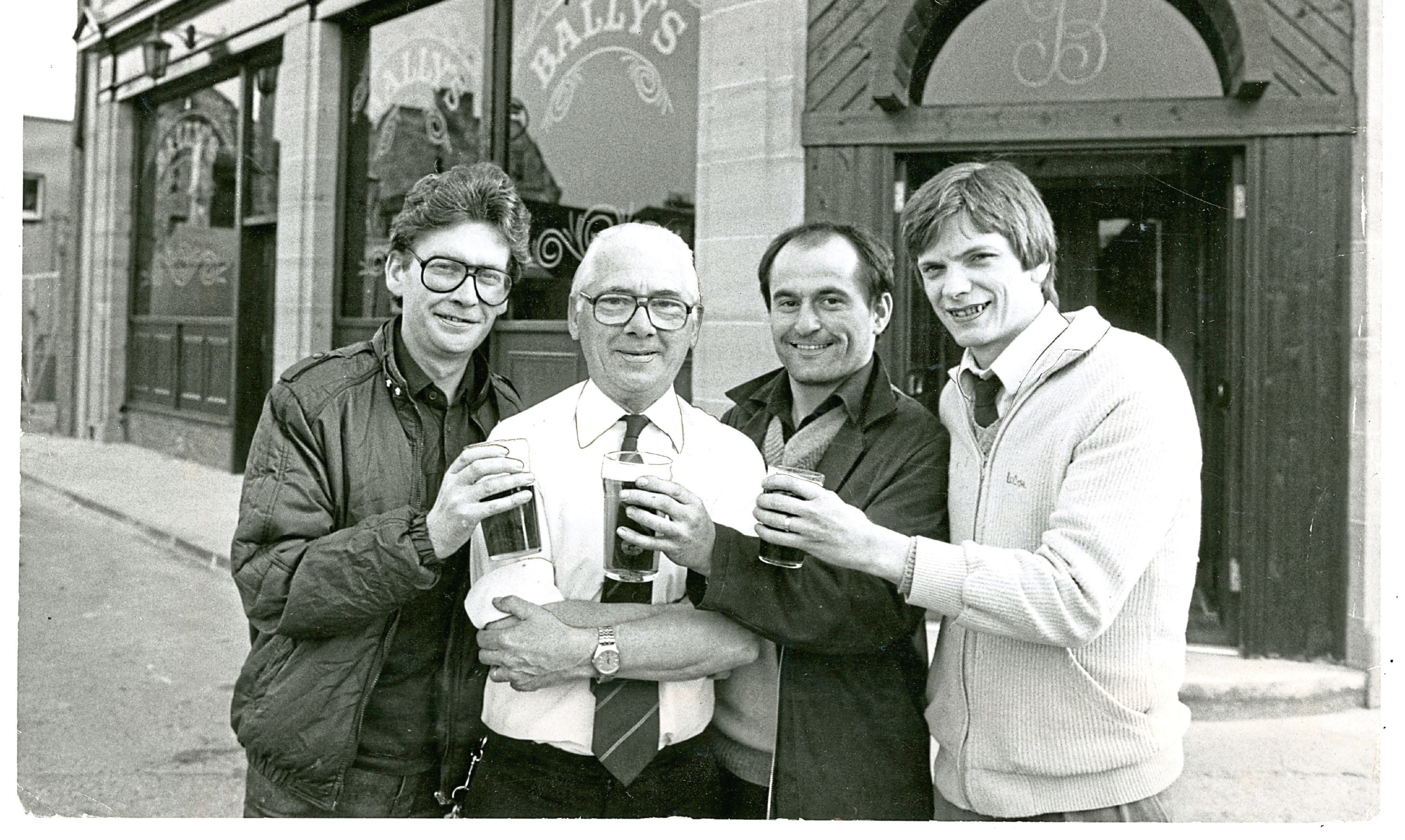Back in the Day - 2 June 2018  (L-R) Bob Palmer, William McKelvie (manager), Joe Wilkinson and John Marshall at the opening of Bally's Bar in Dundee's Westport. H251 1984-05-02 the opening of Bally's Bar in Westoport Dundee (C)DCT