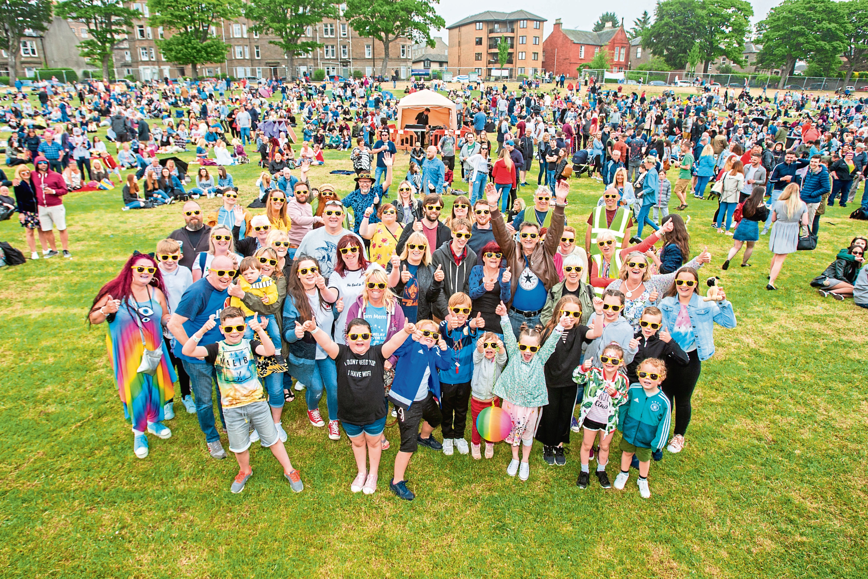 TELE News, unknown reporter Story, CR000 WestFest 2018 event at Magdalen Green, Dundee. Picture shows #SunnyDundee sunglasses were on show. ONLY TO BE USED BY TELEGRAPH AS GLASSES DONATED BY EVENING TELEGRAPH Magdalen Green, Dundee. Sunday 3rd June 2018.