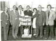 Back in the Day - Monday 4 June 18 Dundee dockers presented Tayside Health Board Chairman Mr John Knox with a £5000 check for an artifical kidney machine at presentation held in D.R.I From L-R - J. Blakes (district secretary), T.G.W.U., Mr John Knox, Mr R. Gunn, charge nurse artificial kidney unit, Dr Ian Duffy, docks branch manager committee, staff Nurse G. Booth, Mr F. Longmuir, chairman, Dundee Dookers' branch, T.G.W.U, and Mr Charles Martin, docks branch committee.   A4450 1979-07-10 Tayside gets check for kidney machine (C)DCT L/Ed 11/07/1979