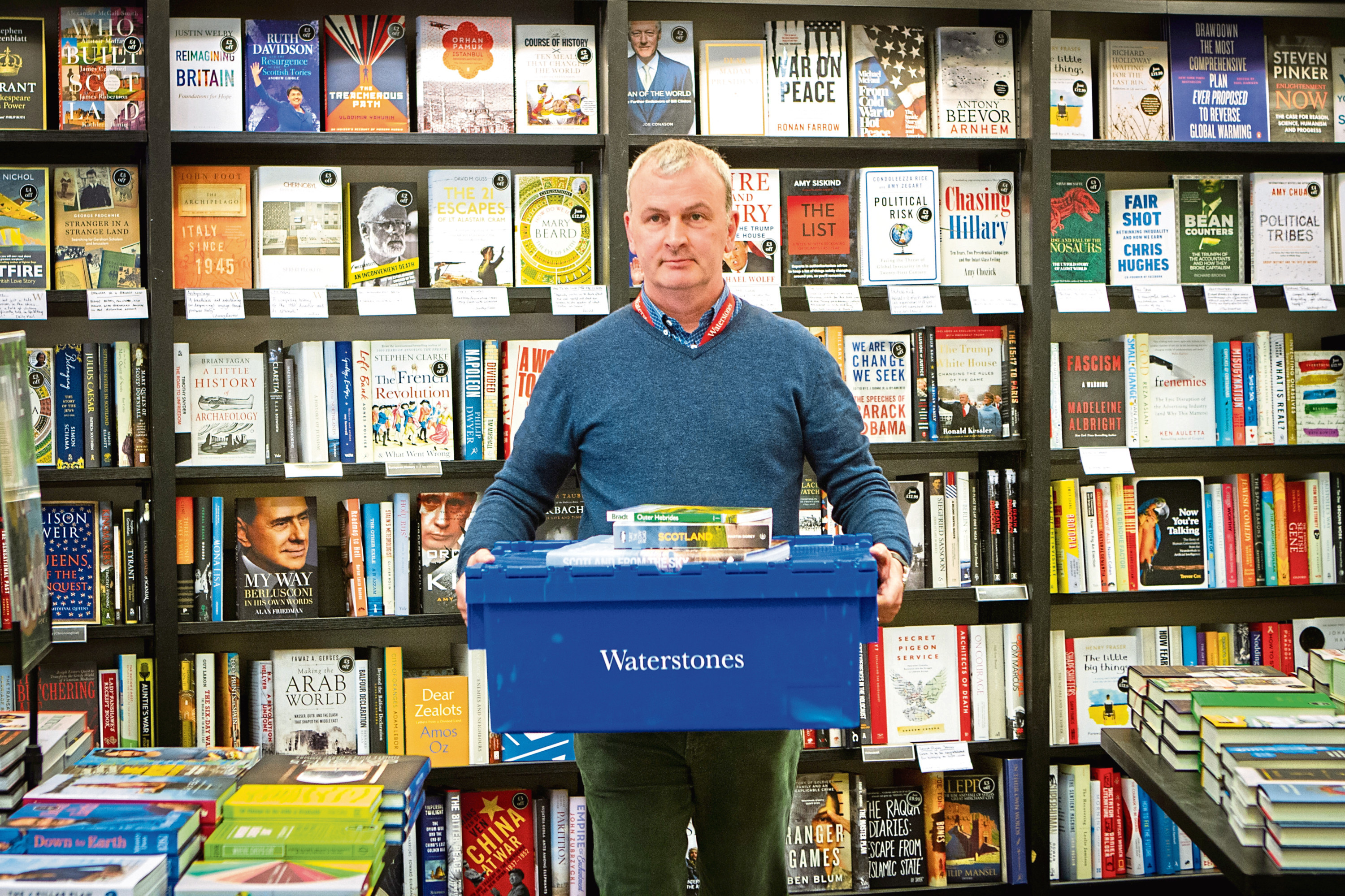 Courier News, Scott Milne Story, CR0001715 Bookshop manager travelling to Outer Hebrides with 'pop-up' bookshop. Picture shows Robin Crawford packing the books for the journey. Waterstones Bookshop, Commercial Street, Dundee. Monday 4th June 2018.