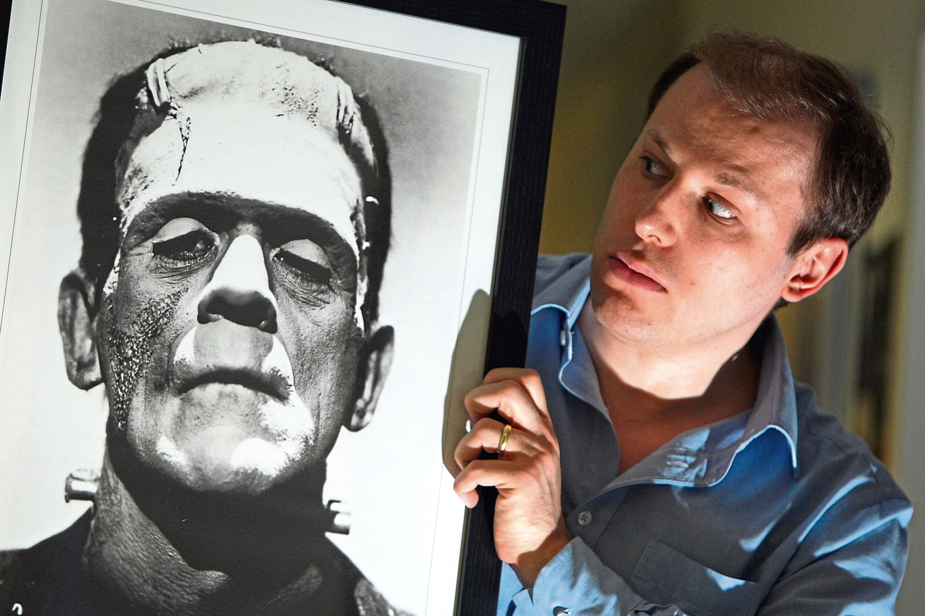 Kris Miller, Courier, 09/11/15. Picture today at University of Dundee shows Dr Daniel Cook, Lecturer in English with a picture of Frankenstein's Monster. Being Human Festival 2015 is set to run from 12th - 22nd Nov with Mary Shelley's formative experiences in Dundee being revisited as part of the festival.