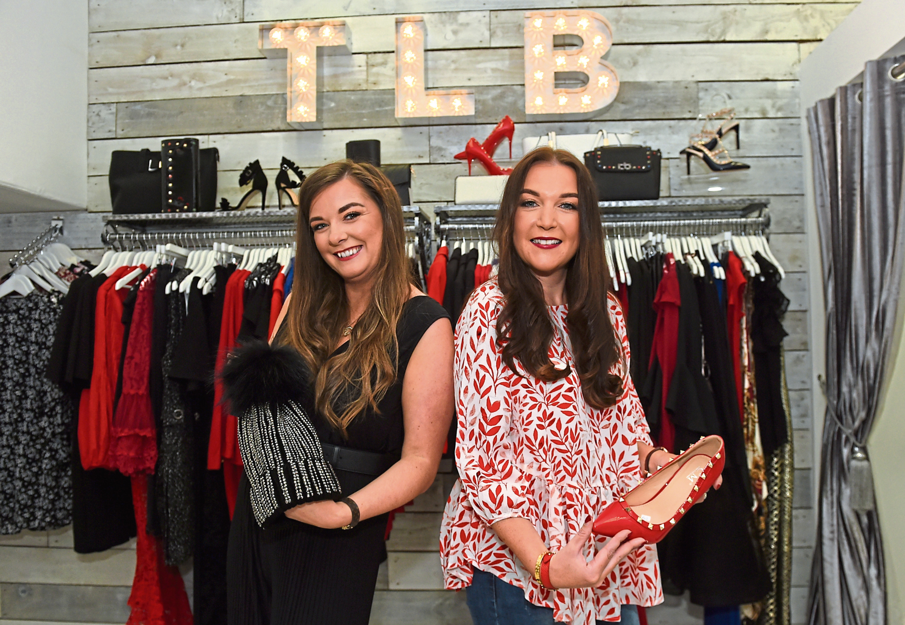 Tiger Lily Boutique is a finalist in the Fashion Retailer of the Year category at the EE Retailer Awards 2017. Pictured from left, Melissa McArthur and sister Debbie Brash. 08/09/17 Picture by HEATHER FOWLIE
