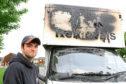 Mark Phin with his damaged van at Scotscraig Road