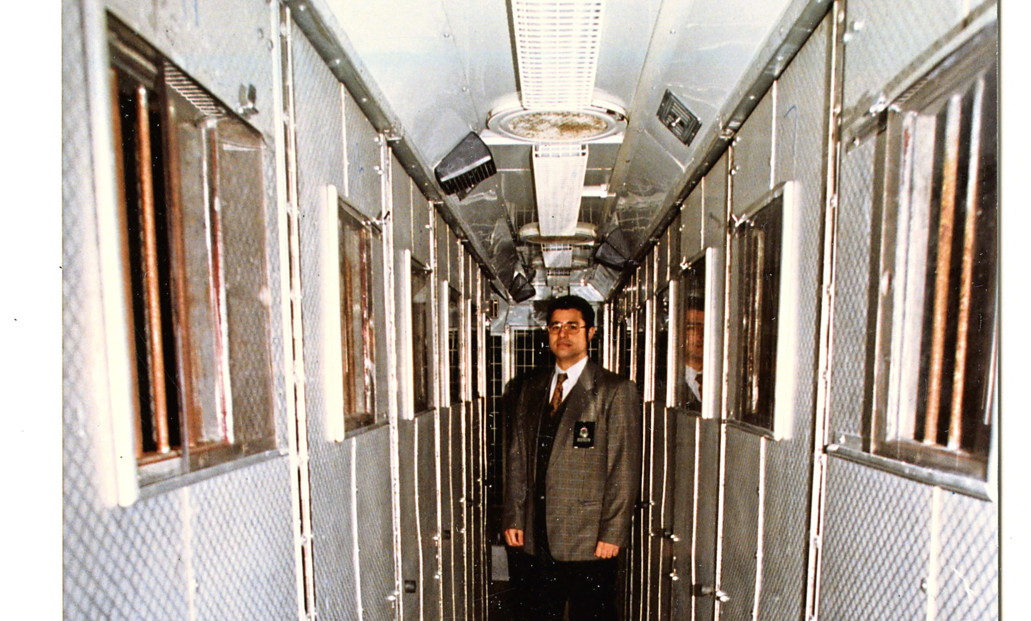 Mike Ahmed from Tayside Police poses inside the 'Jail bus' in 1997