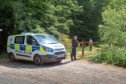 Police at Loch Kinnordy Nature Reserve, where the body was found.
