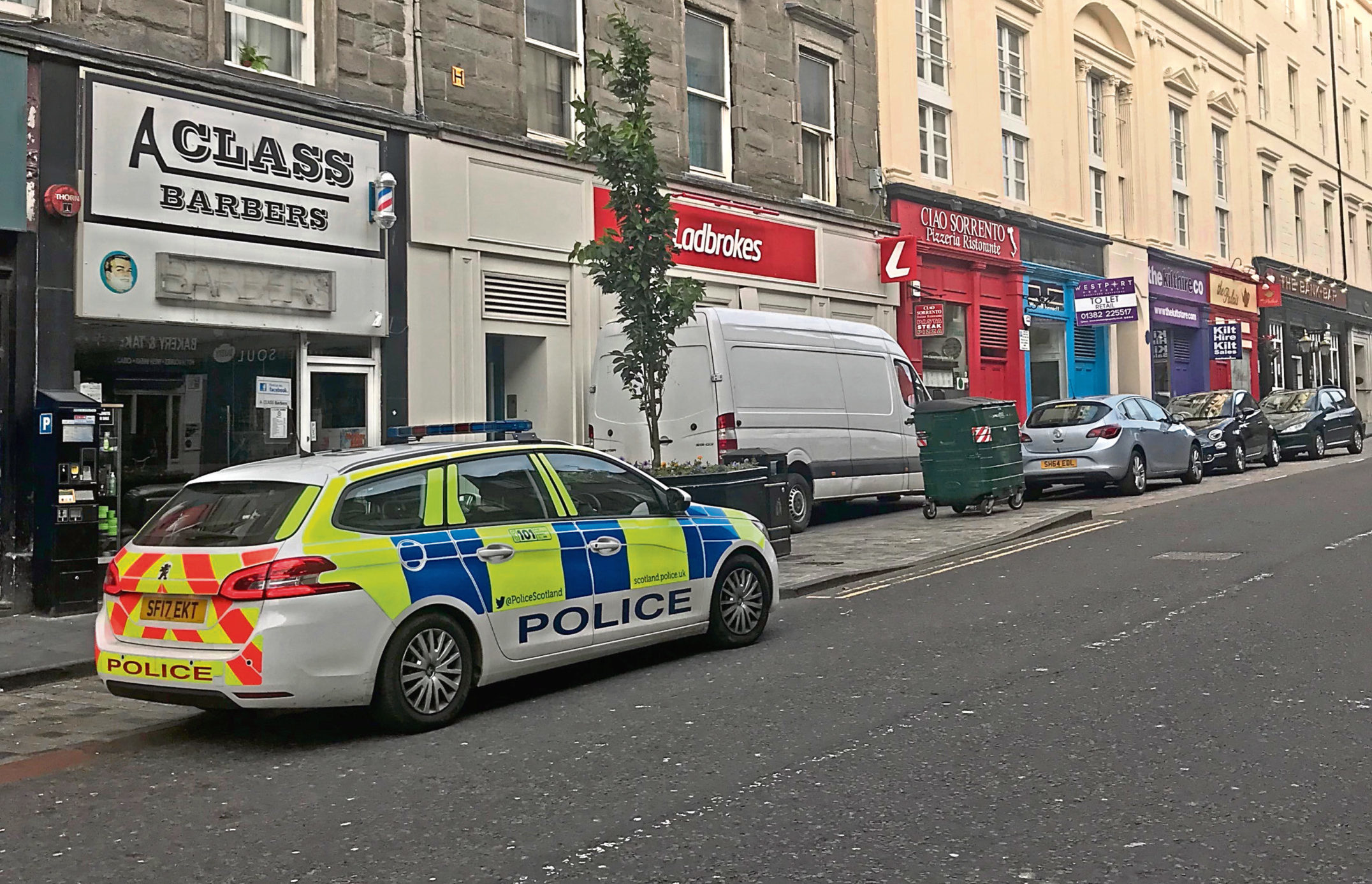 Police at the scene of the incident at Ladbrokes, Union Street.