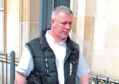 Kevin McLean leaving Dundee Sheriff Court
