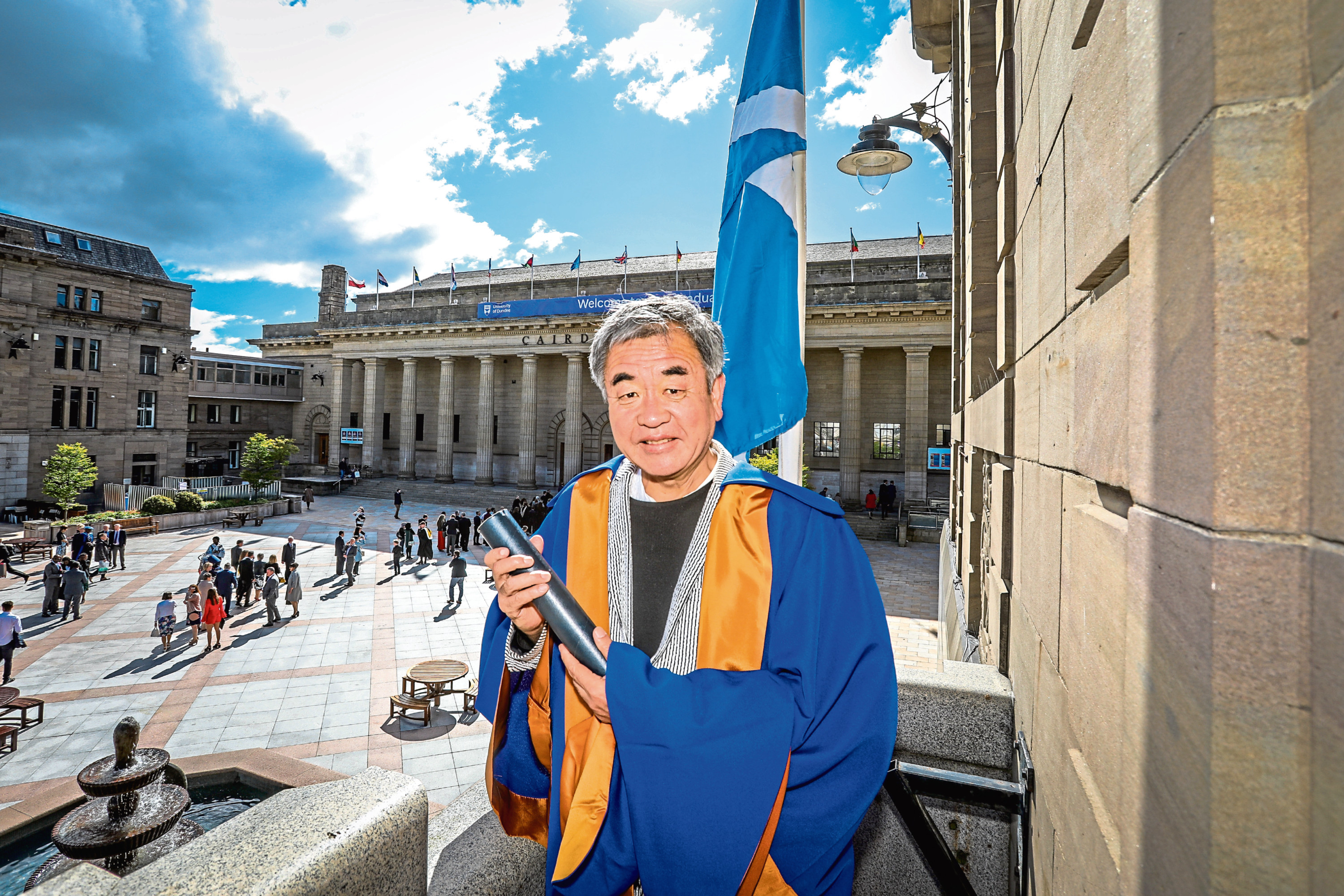 Kengo Kuma with his honorary degree in the city square