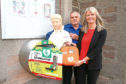 Angela Cain and YMCA secretary Graeme Prophett with the new defibrillator.