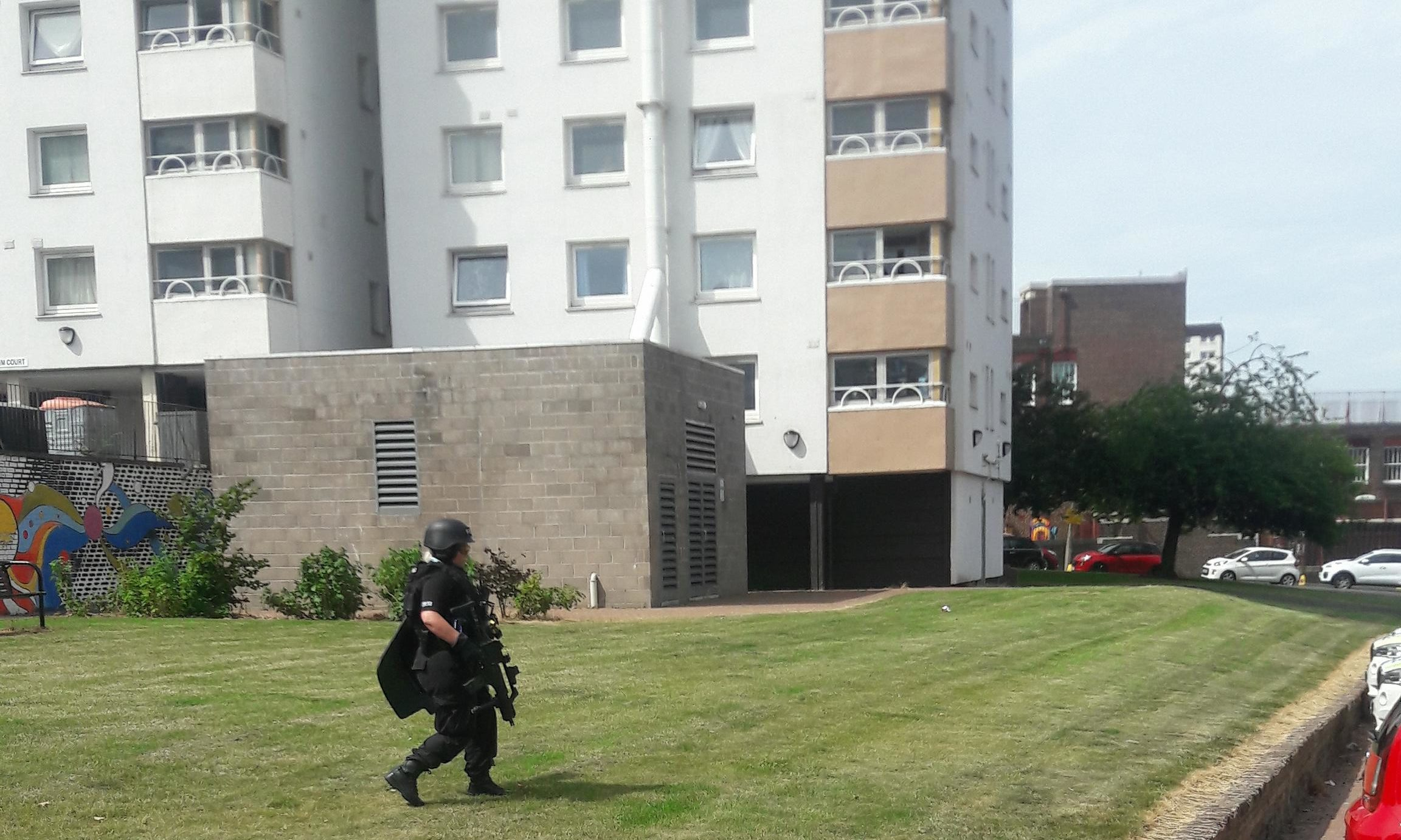 An armed officer making his way to the incident.