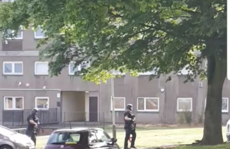 Cops outside Burnside Court, Lochee