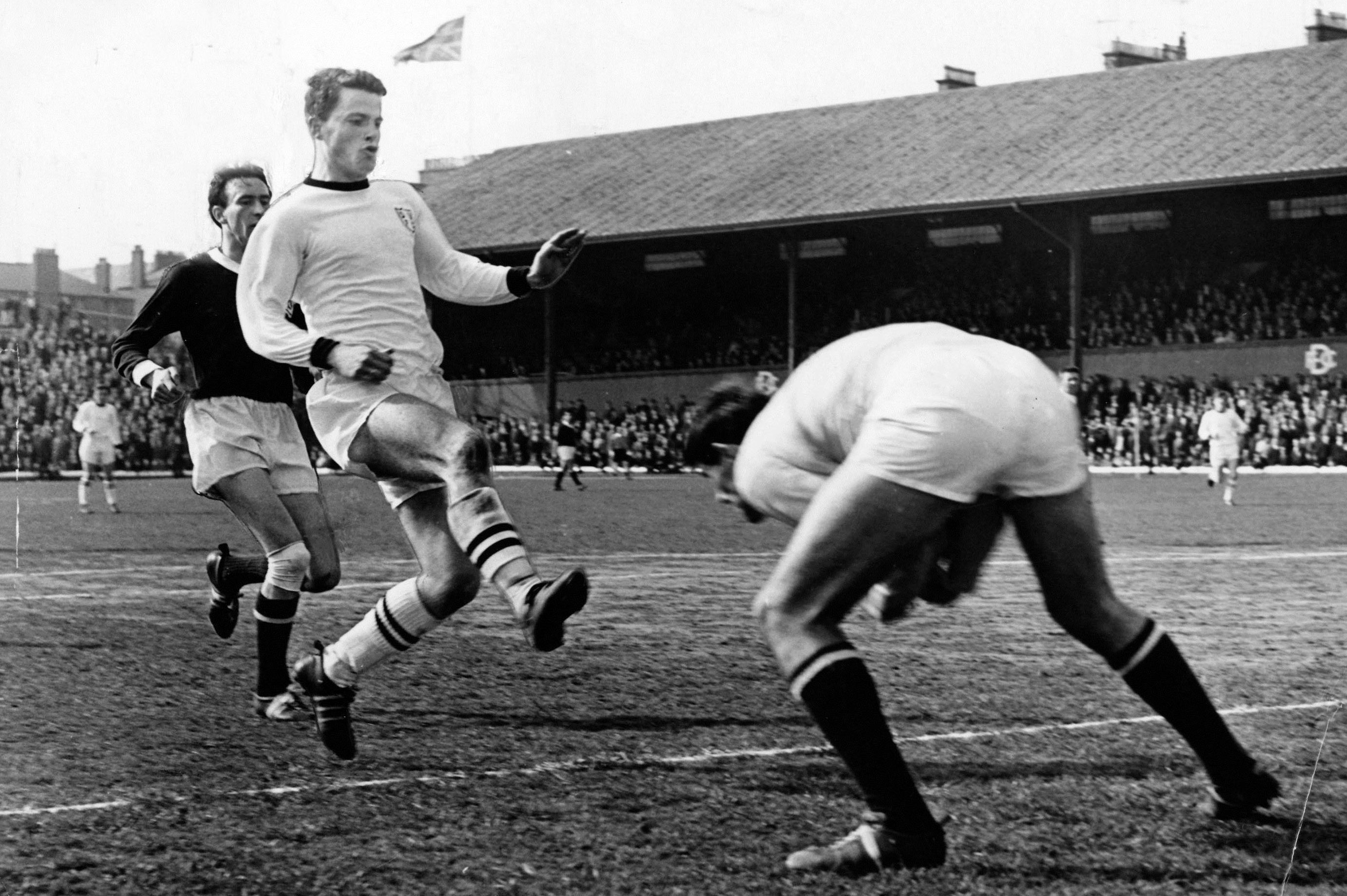 Dundee United legend Finn Dossing tries to toe past the goalkeeper in his time at Tannadice