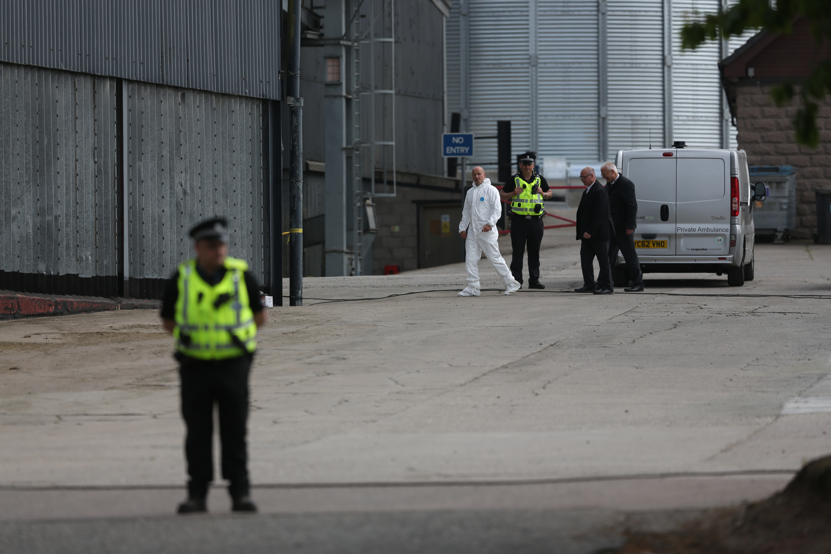 Police at the farm following the tragedy