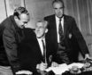 Bob Shankly (right) looks on as Ian Ure signs for Arsenal from Dundee