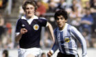 Maradona in action against Paul Hegarty during a Scotland vs Argentina match.